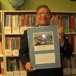 Edgar Riel holding an award