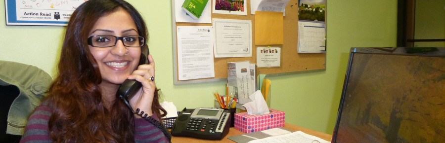 Front desk volunteer answering the phone.