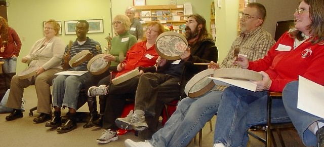 volunteers drumming and singing