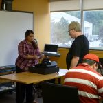 Action Read learners getting the hang of the cash register.