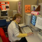 Smiling learner using adaptive techology software on the computer.
