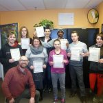 Youth Job Connect participants showing off their Workplace Math Course certificates.