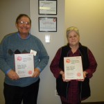 Edgar and Joanne holding their United Way Speaker of the Year Award.