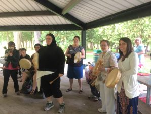 Action Read participants drumming at the picnic.