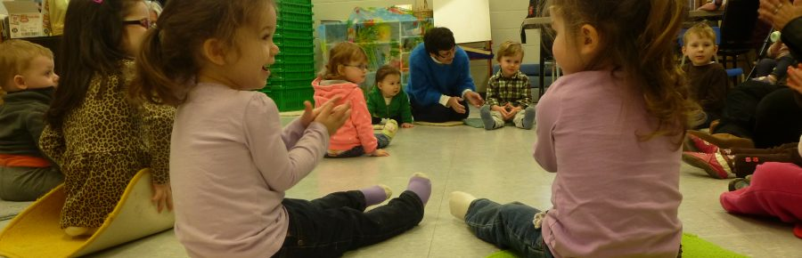 Young children sitting on mats singing songs in programs at Kortright Hills School