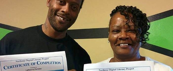 Two people proudly displaying their Northstar certificate.