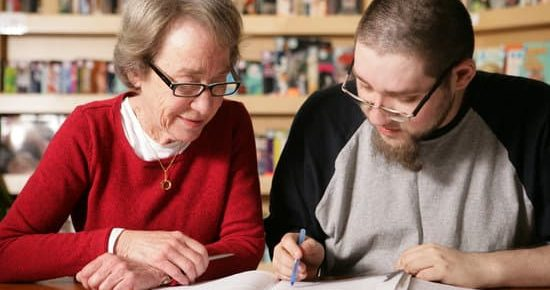 Action Read tutor-learner pair working. Picture from cover of annual report.